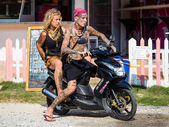 Guy and girl on motorbike — Stockfoto