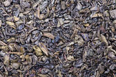 The background and texture of dry green tea — Stock Photo