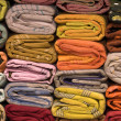 Heap of cloth fabrics at a local market in India. Close up . — Stock Photo #44171275