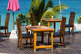 Table and chairs with a beautiful sea view — Stock Photo
