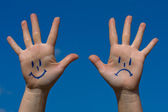 Hands with smiles and sadness pattern — Stock Photo