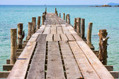 Jetty and beauty beach on daylight — Stok fotoğraf