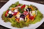Fresh vegetable colorful greek salad — Stock Photo
