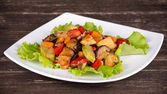 Roasted vegetables on a white plate — Stock Photo