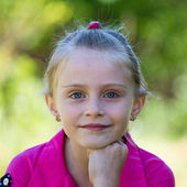 Cute little girl on the nature in summer day — Stock Photo