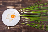 Egg , chives, plate, knife and fork — Stock Photo