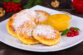 Cheese pancakes with honey — Stock Photo