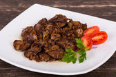 Chicken livers in a creamy sauce with onion — Stock Photo