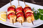 Tasty grilled meat and vegetables on skewer — Stock Photo