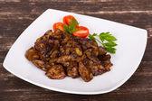 Fígados de frango em molho cremoso com cebola — Foto Stock