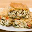 Pita bread wrapped with cottage cheese and vegetables — Stock Photo #48770445