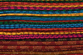 Heap of cloth fabrics at a local market in India. — Foto Stock