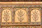 Indian ornament on wall of palace in Jaipur fort India — Stock Photo