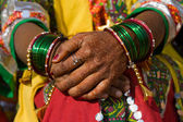 Henna on hands of bride from India — Stock Photo