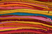 Heap of cloth fabrics at a local market in India — Foto Stock