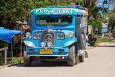 Jeepneys passing, Philippines inexpensive bus service. — Stock Photo