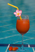 Tomato juice at the swimming pool — Stock Photo