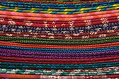 Heap of cloth fabrics at a local market in India. Close up . — Foto Stock