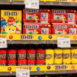 Selection of chocolate candy M&M's on the shelves in a supermarket Siam Paragon in Bangkok. — Stock Photo #50197107