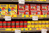 Selection of chocolate candy M&M's on the shelves in a supermarket Siam Paragon in Bangkok. — Stock Photo