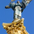 Independence monument in Kiev, Ukraine. This is a statue of an angel, made of copper, and gold plated, standing on a tall pillar, in the center of Kiev, Ukraine. — Stock Photo #50383583