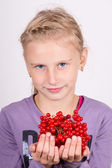 Young girl holding a bunch of viburnum — Photo