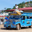 Постер, плакат: Jeepneys passing Philippines