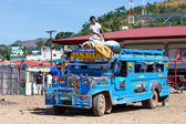 Jeepneys passing, Philippines — Stock Photo