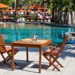 Table and chairs in empty cafe next to the pool — Stock Photo #51248957