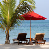 Beach chair and umbrella on the beach in sunny day , Thailand — Stock Photo