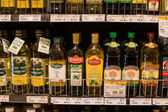 Selection of olive oil on the shelves in a supermarket Siam Paragon in Bangkok. — Stock Photo