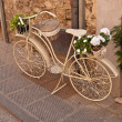 Old white bike on street — Stock Photo #18137543