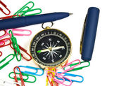 Paper clips, pens, compass on white background — ストック写真