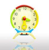 Colorful wooden clock isolated — Stock Photo