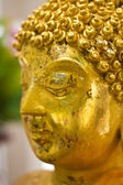 Close up golden buddha statue — Stock Photo