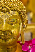 Close-up to golden buddha statue — Stock Photo