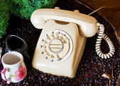Old phone on the table  — Stockfoto