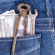 American dollar bills and tools in jeans pocket — Stock Photo #44475641