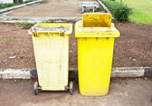Old yellow trash in the park — Stock Photo