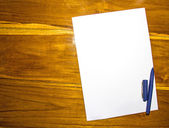White paper and pen on the wooden table — Stock Photo