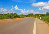 Empty local road and blue sky with clouds — Foto de Stock