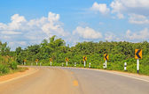 Empty local road and blue sky with clouds — Stockfoto