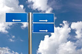 Blank Blue Road Sign Against Light Cloudscape — Stock Photo
