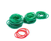 Green and red rubber bands against isolated — Stock Photo