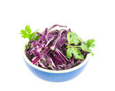 Red cabbage leaves cut in a cup, on white background — Stock Photo