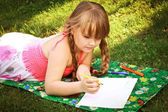 A little girl draws — Stock Photo