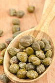 Capers in spoon — Stock Photo