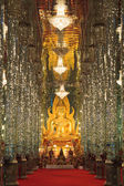 Golden Buddha statue at Cathedral glass, Temple in Thailand — Stock Photo