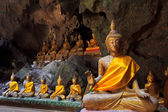 Old Buddha in a cave thailand — Stock Photo