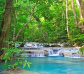 Waterfall and blue stream — Stock Photo